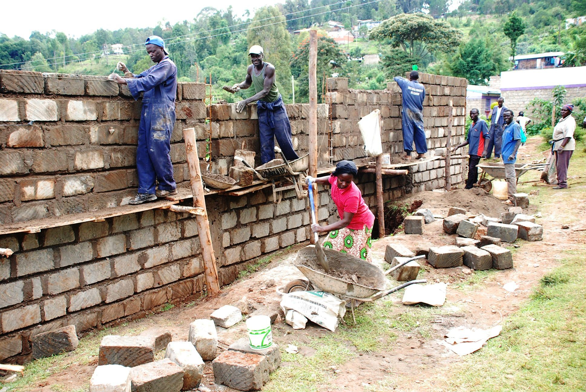 Men at work in Kabarnet Stadium during the Construction of a perimeter wall in the studium.